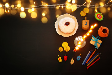 Top view image of jewish holiday Hanukkah background with traditional spinnig top, menorah (traditional candelabra)