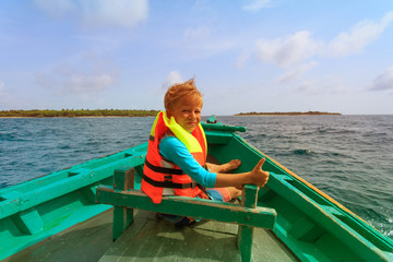 little boy enjoy boat ride at sea