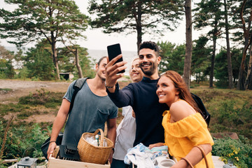 Friends taking selfie during picnic