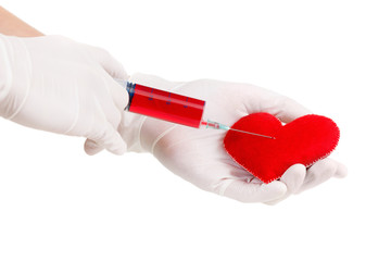 Hands in gloves, syringe and heart symbol. Isolated on white. Health concept