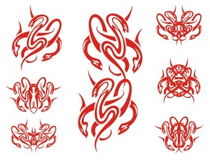 Red snakes symbols in tribal style. A set of the twirled snake symbols isolated on a white background
