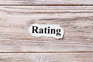 RATING of the word on paper. concept. Words of RATING on a wooden background