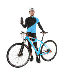 Young sporty cyclist with bicycle and beverage on white background