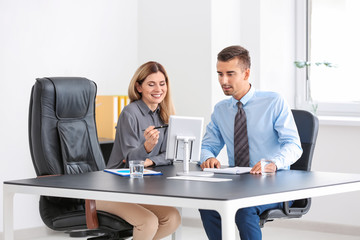Young woman consulting man in office