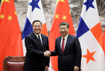 Panama's President Juan Carlos Varela shakes hands with China's President Xi Jinping during a signing ceremony in Beijing