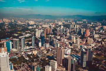 Modern architecture, business office building, cityscape background. Kuala Lumpur skyline. Travel to Malaysia. Urban skyscrapers. Modern city. Financial district. Aerial view of downtown. Luxury hotel