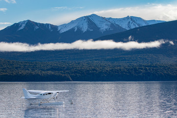 water plane floating over te anau lake fiordland national park new zealand