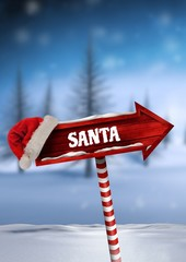Santa text on Wooden signpost in Christmas Winter landscape with