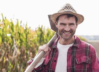 Portrait of happy farmer on field