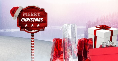 Merry Christmas text and gifts with Wooden signpost in Christmas