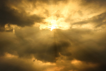 sun rays through cloudy sky, hope or opportunity concept
