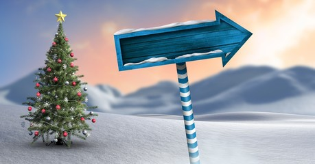 Wooden signpost in Christmas Winter landscape with Christmas