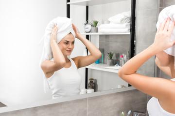 Woman putting towel on head