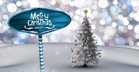 Merry Christmas text on Wooden signpost in Christmas Winter