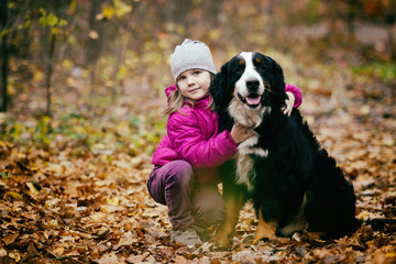 child hugs the dog