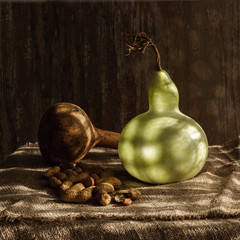 Still life with two Lagenaria or bottle calabash Gourds Pumpkins and peanut nuts with shadows