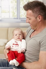 Father holding baby in arms