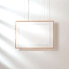 Horizontal poster with wooden frame mockup hanging on the wall with shadows, 3d rendering