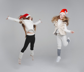 cute happy children with santa hats