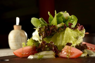Salad of greens leaves and artichoke