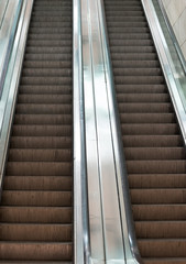 Electric escalator in metro. Moving staircase.