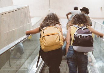 Passengers using electric escalator in metro.