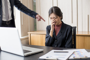 Desperate young Asian businesswoman unable to work with stress situation, suffering stress, boss come to order many job to her, Woman in Stress situation Concept. Vintage tone.