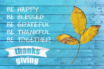 Happy thankgsgiving day with design poster on blue wooden texture