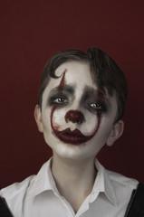 Portrait of sad clown. Art photography.
