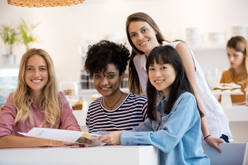 Group of young women together in cafe, portrait
