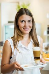 Waitress carrying drink, portrait