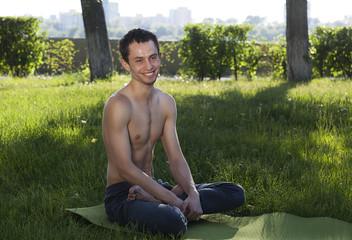 young man doing yoga, smile and happiness