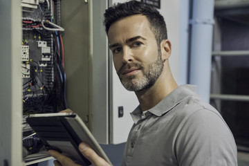 Man working in electrical control cabinet