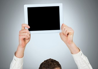 Man holding tablet with grey background