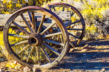 Two Wooden Wagon Wheels At Sunrise