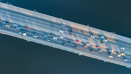 Aerial top view of bridge road automobile traffic jam of many cars from above, city transportation concept