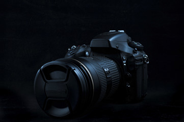 High end digital camera viewed in dark background