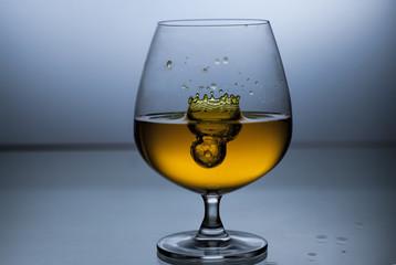 Wine splash in glass