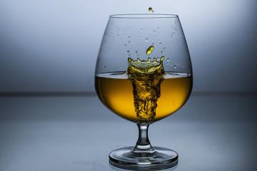 Wine liquid drops in glass high speed