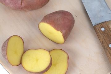 sliced potatoes on a Board and a sharp knife