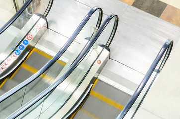 Empty Escalators Stairway Top View. Motion Blur Moving Staircase