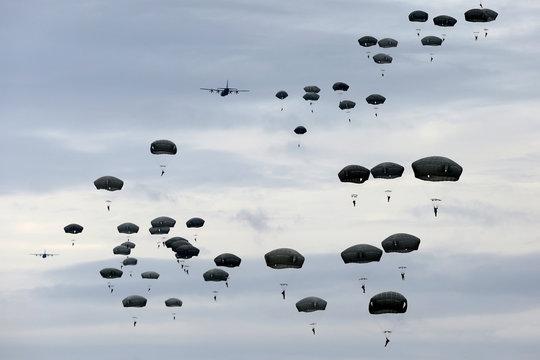Jumping Parachutists