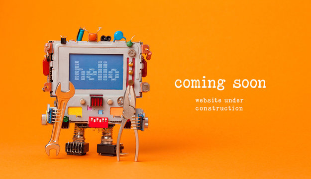 Web site under construction Coming Soon template page. Toy robot with hand wrench and pliers. Orange background