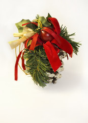 New Year`s and Christmas cone - toy with spruce branch with red and green ribbons