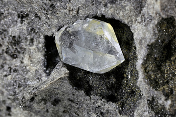 Herkimer diamond nestled in bedrock isolated on white background