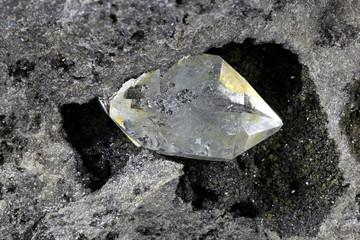 Herkimer diamond nestled in bedrock isolated on white background