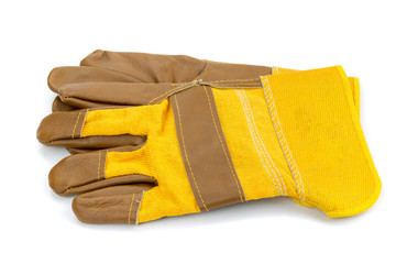 Yellow leather and cotton protective gloves cut out on a white background.