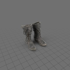 Upright worn leather boots
