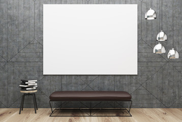 Gray room with a poster and a bench