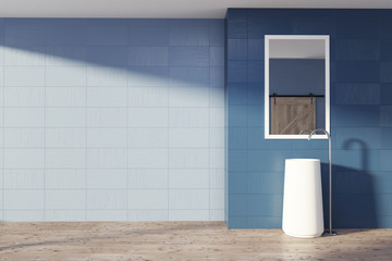 Blue bathroom interior, sink and mirror